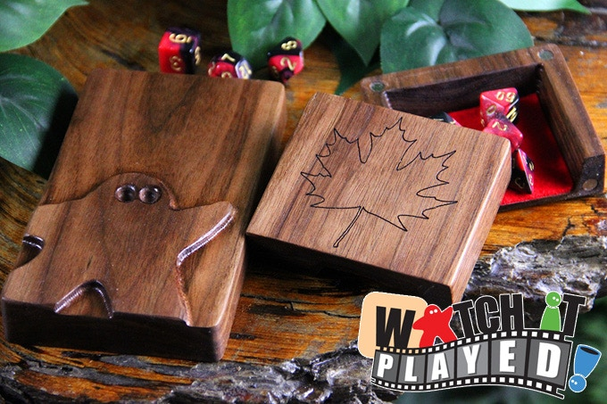 Exclusive Dice Tower in Black Walnut with the Watch It Played Meeple, Maple Leaf engraving, and Red felt.