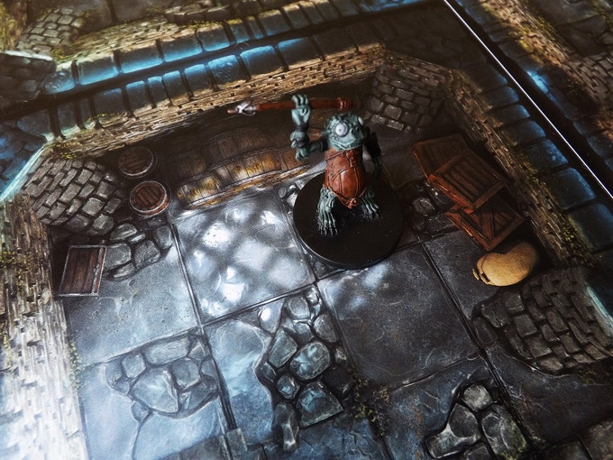 Sewer map-tiles with a D&D miniature