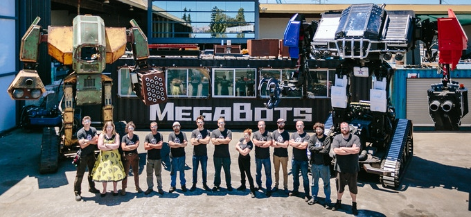 The MegaBots team with Iron Glory and Eagle Prime. Yes, this is a real job.