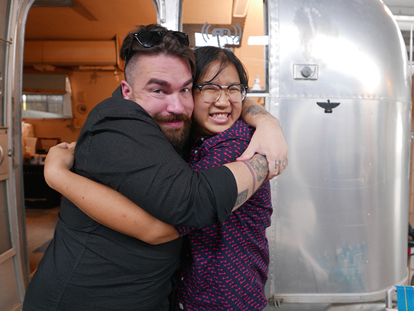 Soleil hugging it out with writer and fellow tattoo fiend Isaac Fitzgerald
