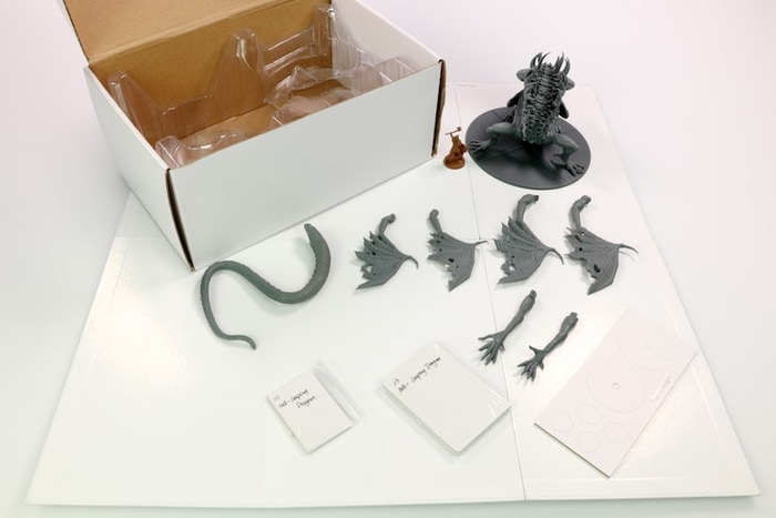 White Box Sample of the Gaping Dragon. Push fit parts shown along with the board/gaming components.