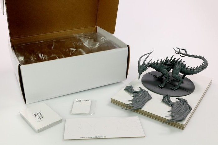 White Box Sample of Black Dragon Kalameet. Push fit wings shown along with gaming components/cards.