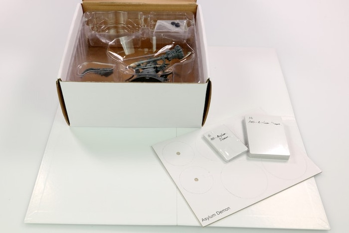 White Box Sample of the Asylum Demon. Packed away with components displayed.