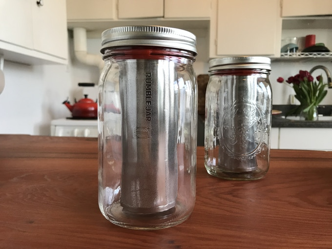 the new, sleeker jar is on the left & the traditional jar is on the right