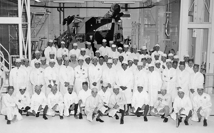 Grumman Aircraft workers pose in front of their creation: the Apollo Lunar Module
