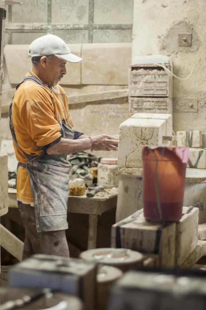 Unmolding the piece in the workshop of ceramic
