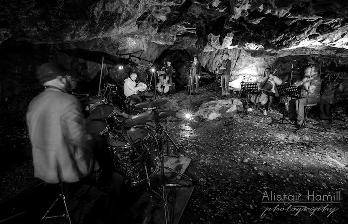 3000 years ago an on-the-run musician wrote songs while hiding in caves. His lyrics survived - we're recording them in an Irish cave!