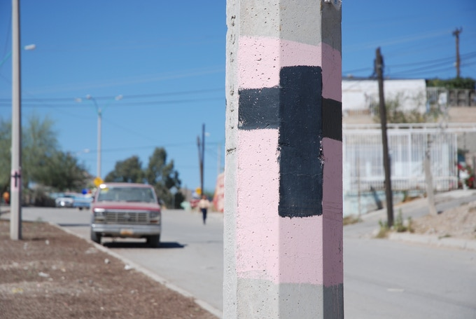 Protesting - Black crosses on pink on every light pole in Cd Juarez