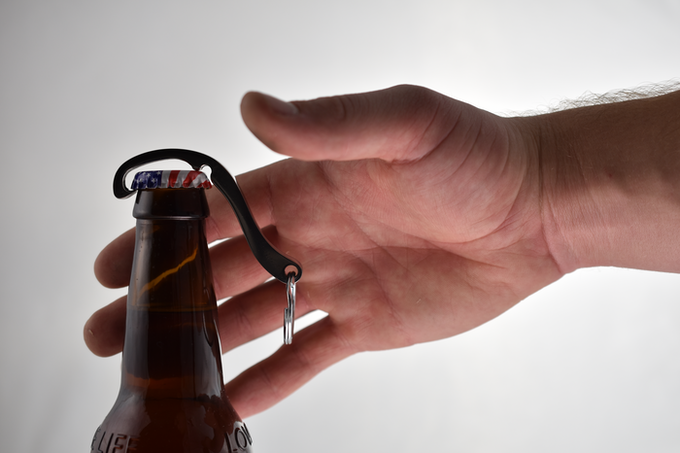 Cap Snap hooks onto the lip of the bottle cap and rests in place