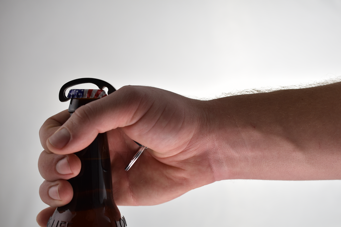 Grabbing the neck of the bottle puts the hand in position to squeeze...