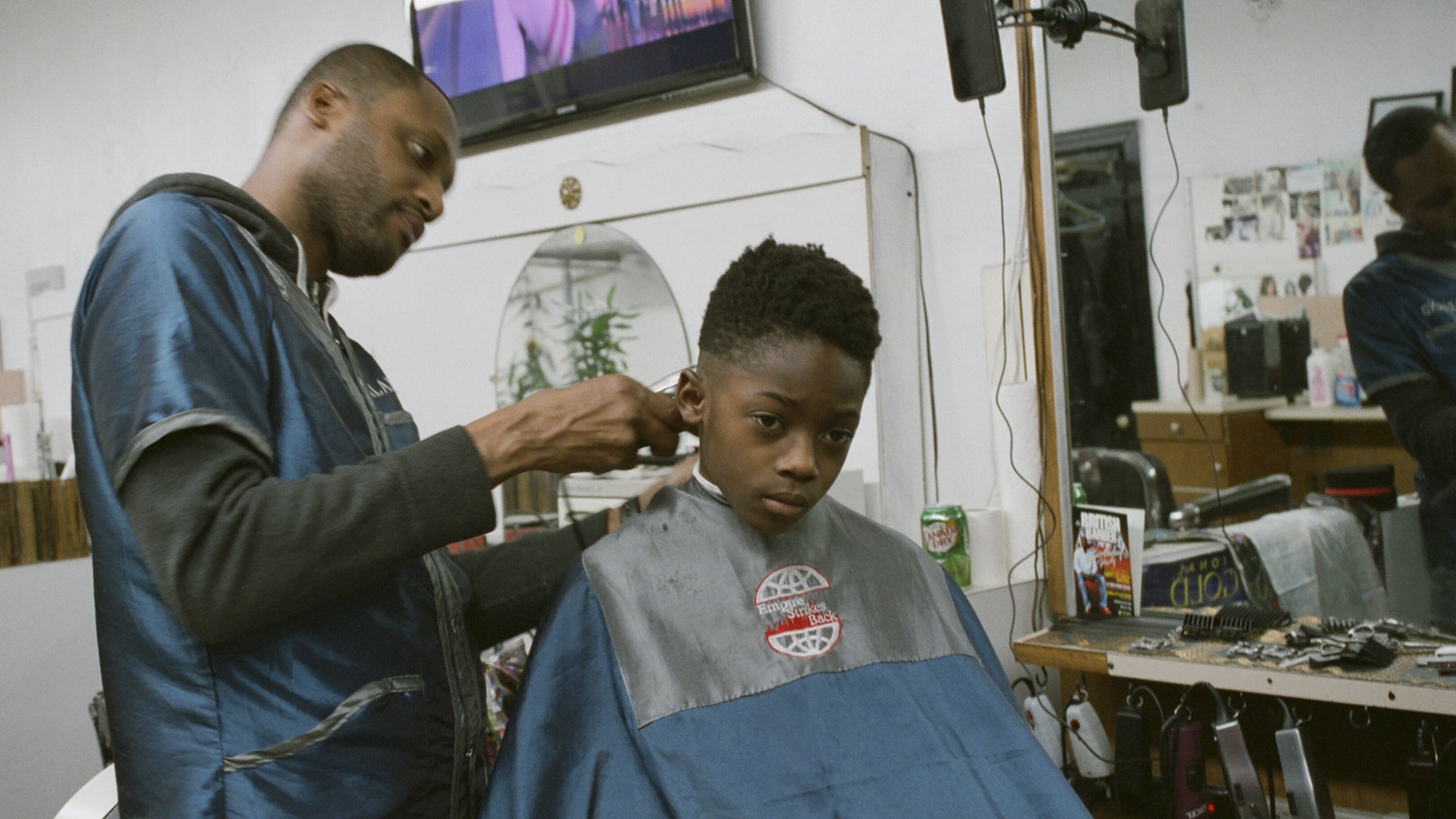 A photographic exploration of the ways communities within black barbershops help cultivate identity and wellness.
