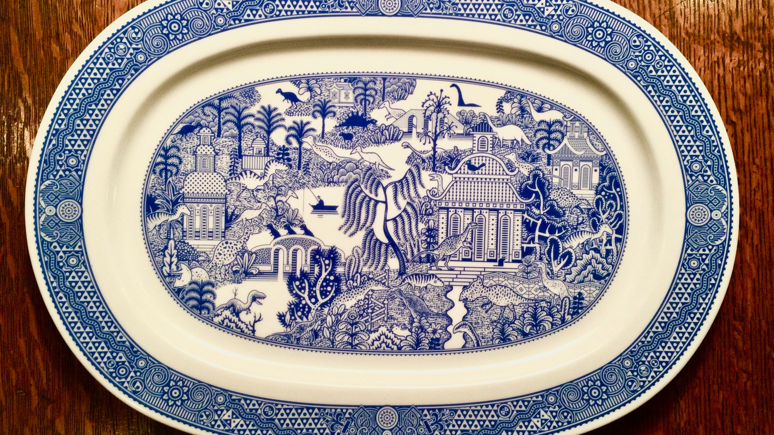 A host of hungry dinosaurs enhance this porcelain platter.
