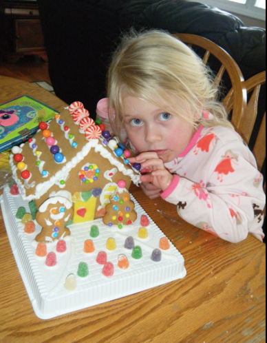 Sneaking candy from the gingerbread house.