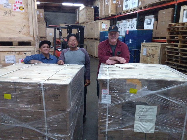 From right to left, Bob, Ray, and his daughter Crystal, who unloaded our games