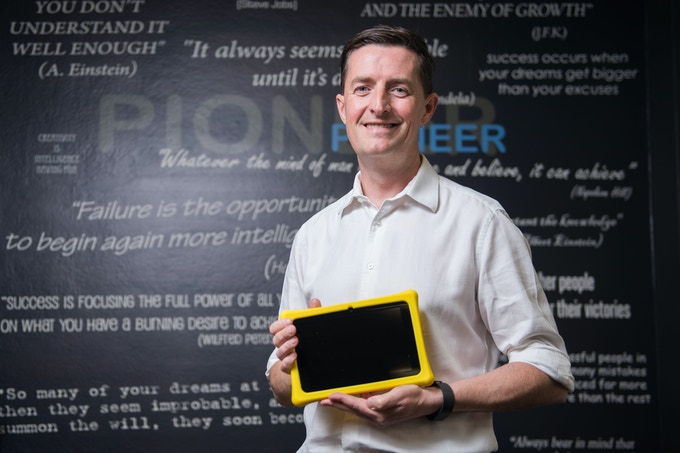 Adrian with Squaggle tablet (looking a bit more clean shaven!)