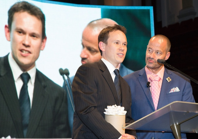 Maths geek and comedian Adam Spencer presenting me with an AMP Tomorrow Maker Award at Sydney Town Hall.