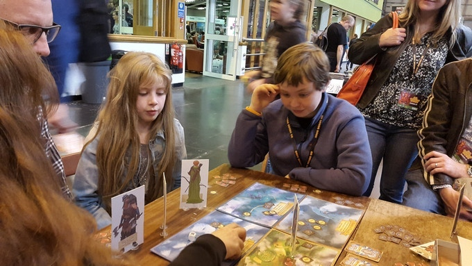 Deep in thought at the UK Board Games Expo... if he jumps out of the realm he's safe, but if he stays he can collect additional victory points and gold... but a single big hit could kill him.