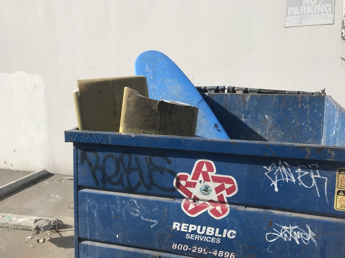 Broken Boards in the dumpster.