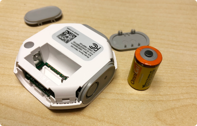 Tabs Home Monitoring Devices uses 1/2 AA Batteries like shown (included) and lasts years before it needs a charge.