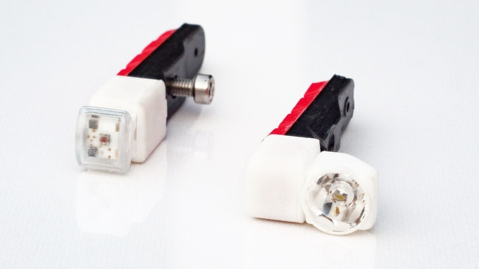 Here you see the current Magnic Microlight rear light (left) and front light made of 3d-printed material with fully functionable contactless generator & PCB board electronic.