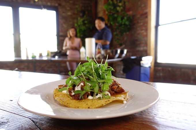 Sisig Tostada [pork ears, pork snout, pork belly, pork butt, lime crema, micro cilantro]