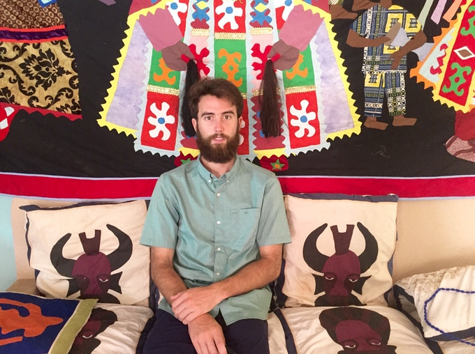 Tim surrounded by Ives' handmade pillows