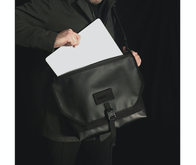 Access the contents of the bag without opening the flap. Zipper is waterproof.