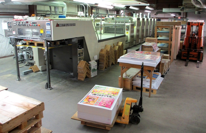 The giant press that the cards are printed on.