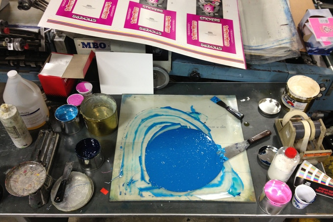 Hand-mixing the ink for the wrappers.