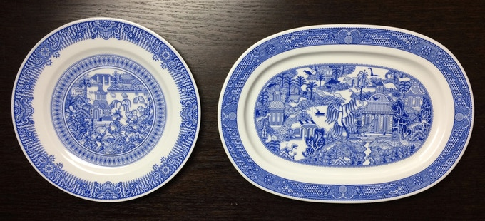 Platter (right) is much bigger than a Calamityware dinner plate (left), but not so big that you'll need to move to a bigger house.