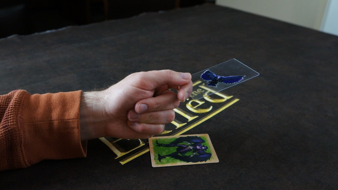 Character movement is important as you must release your weapon throw from behind your character card.