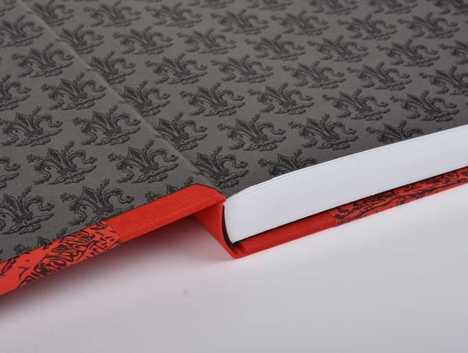 CLOTH and HALF-LEATHER copies are bound with Fleur-de-lis letterpress endpapers.