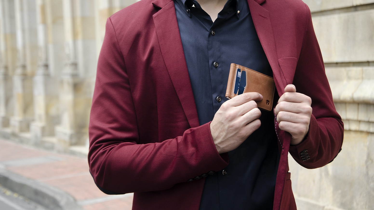 """Carry the things you need & access them easily with our patent pending """"Quick Draw"""" Wallet. Easily remove any card with a single touch."""