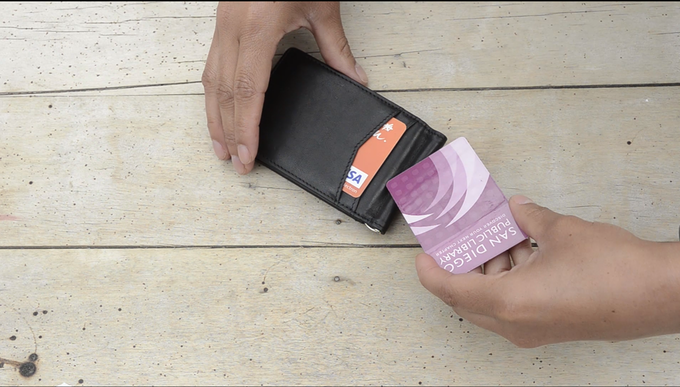 "Redesigned with two ""Quick Draw"" card pockets on both exterior sides of the wallet"