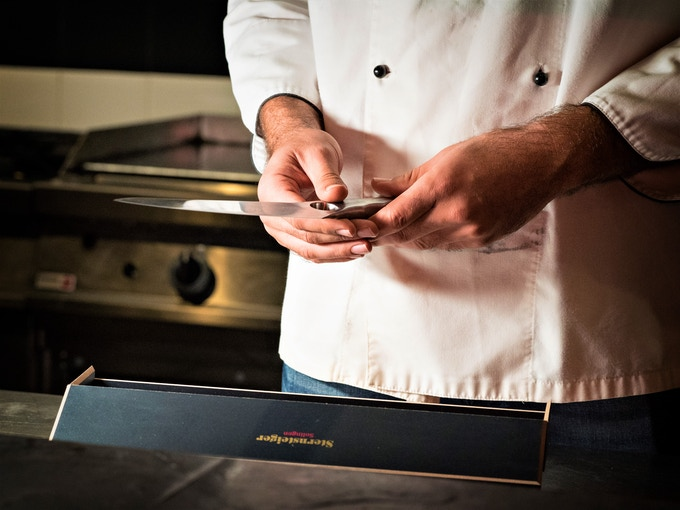 Achilles in Gourmet Chef's hand