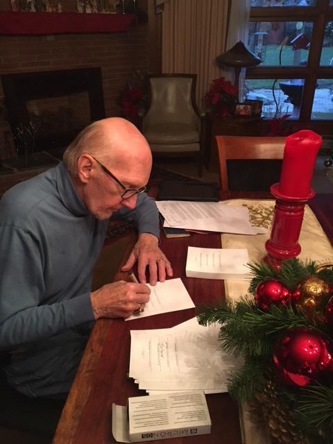 Phil Jurus signing the signature plates.