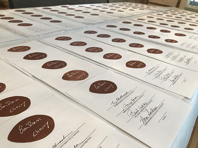 Over 300 signature plates signed, stamped, and numbered.