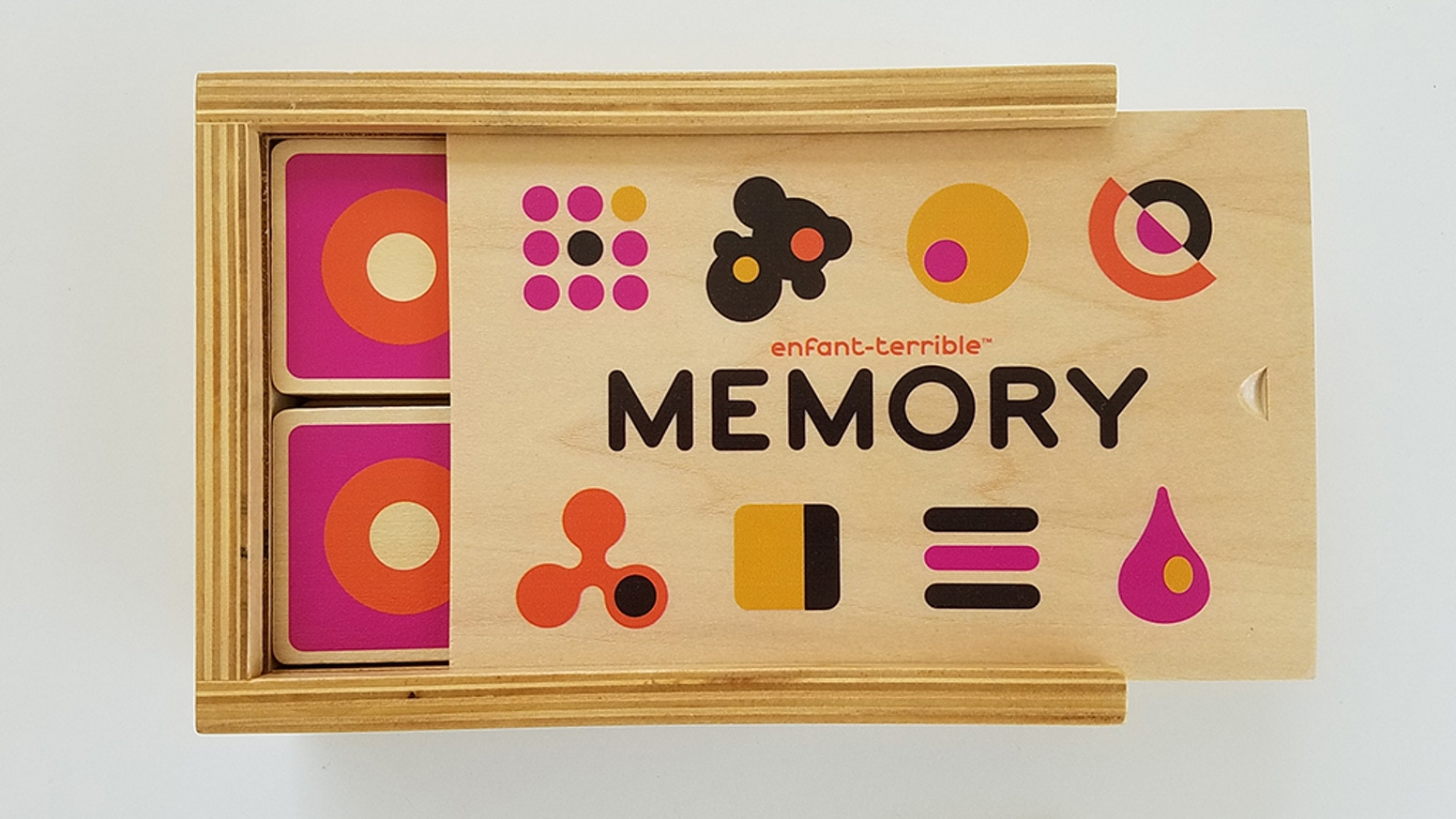 48 pcs wooden memory game with colorful abstract icons silkscreened on both sides.  In classic wooden storage box. Generations of fun!