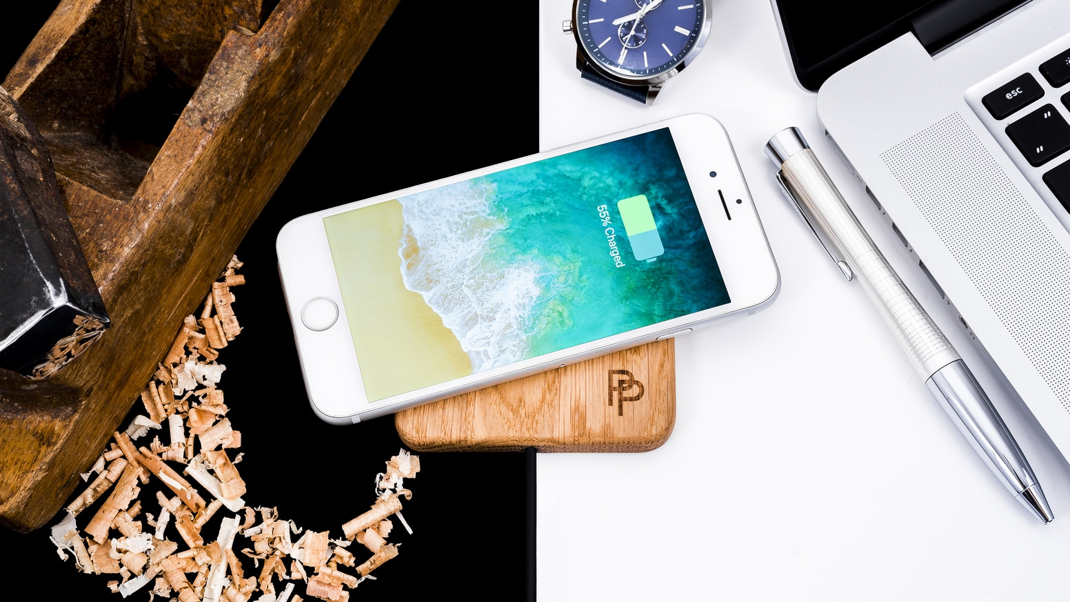 The wireless handcrafted wooden charging station just place your phone on the top and let