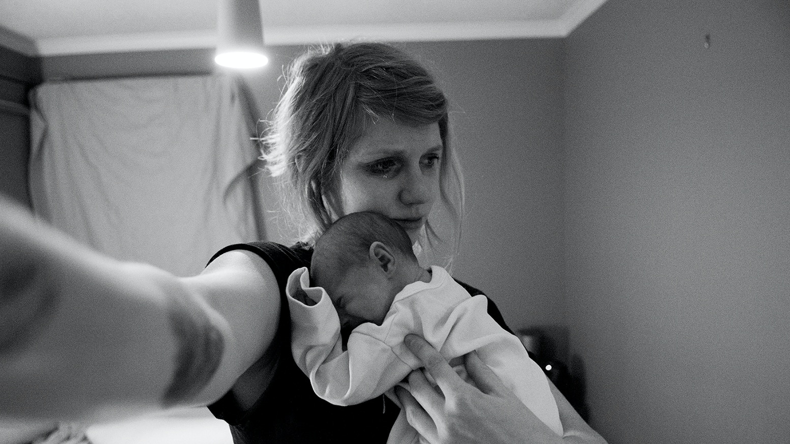 Born is a photobook with an honest, intimate look at the transition of becoming a mother.