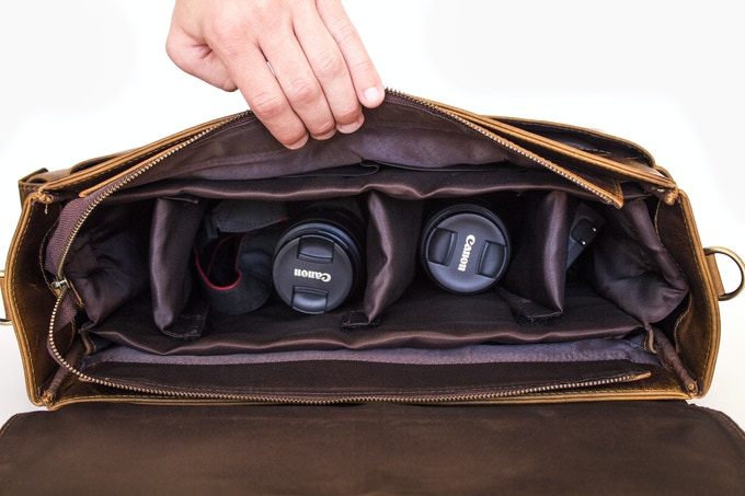 Padded insert with removable dividers turns this into the perfect camera bag.  Laptop still fits in bag with padded insert installed.