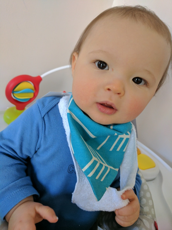 My son trying the first protoype (the bib was too small + the long v-shaped teether attachment was not working how I thought. So we made some awesome changes!)