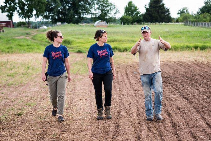 Founding butchers Cecilie May and Heather Marold Thomason with partner farmer Beau Ramsburg at Rettland Farm in Gettysburg, PA