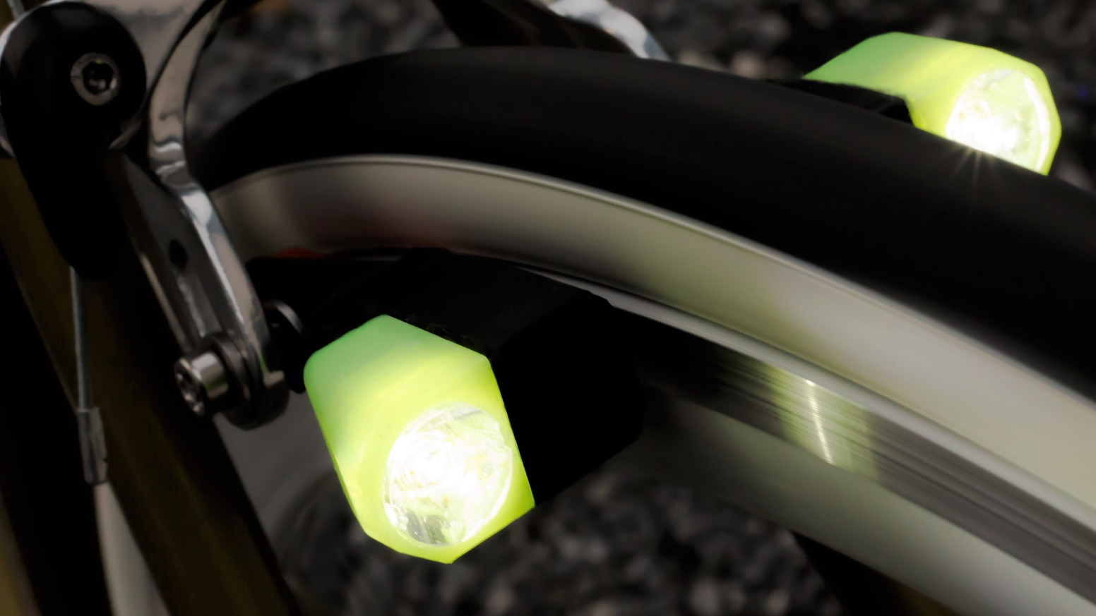 Bicycle lights in brake shoes powered by eddy current generators: no mechanical friction, cables or wheel magnets. With newest Cree LED