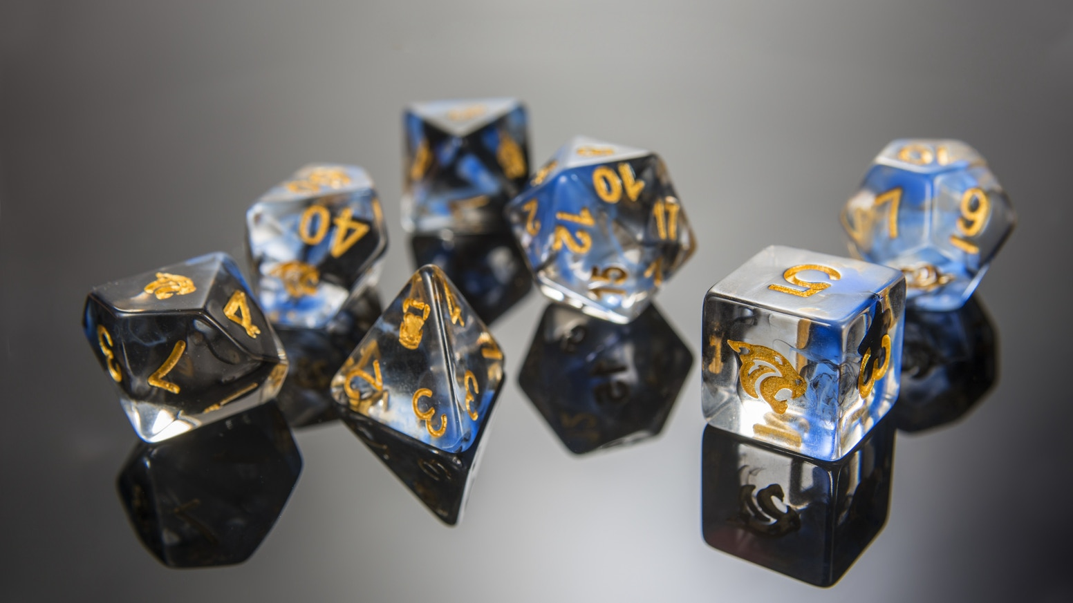 Spirits trapped inside a 2 tone swirl translucent polyhedral Dice set. Which spirit will you choose?