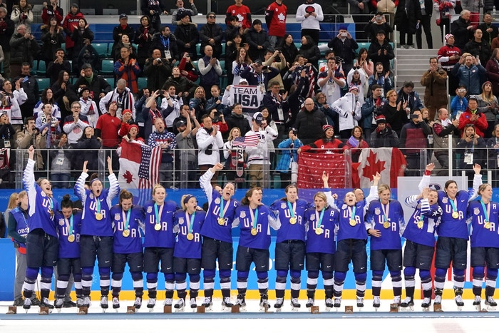 Members of team USA receiving their gold medals after the game.