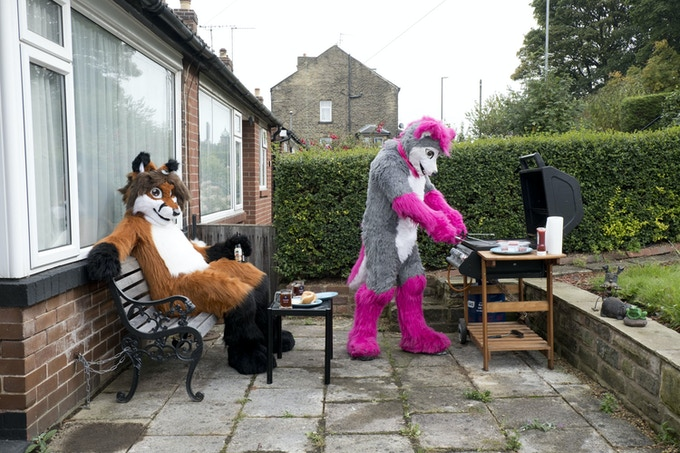 """""""I always knew I was different. Spiritually you might feel you're a cat or a dog. By dressing up, you're replacing that"""" Lupestripe (R), a wolf and Syrrus, a fox at home in Leeds (Limited edition print)"""