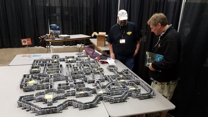 Keith Hershey, Jr. and Frog God Bill Webb examining the printed pieces at GameHoleCon 2017.