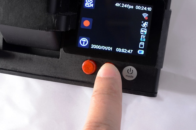 Three buttons for; Turn on and off, access the menu, take photos or videos and connect the Wirelles