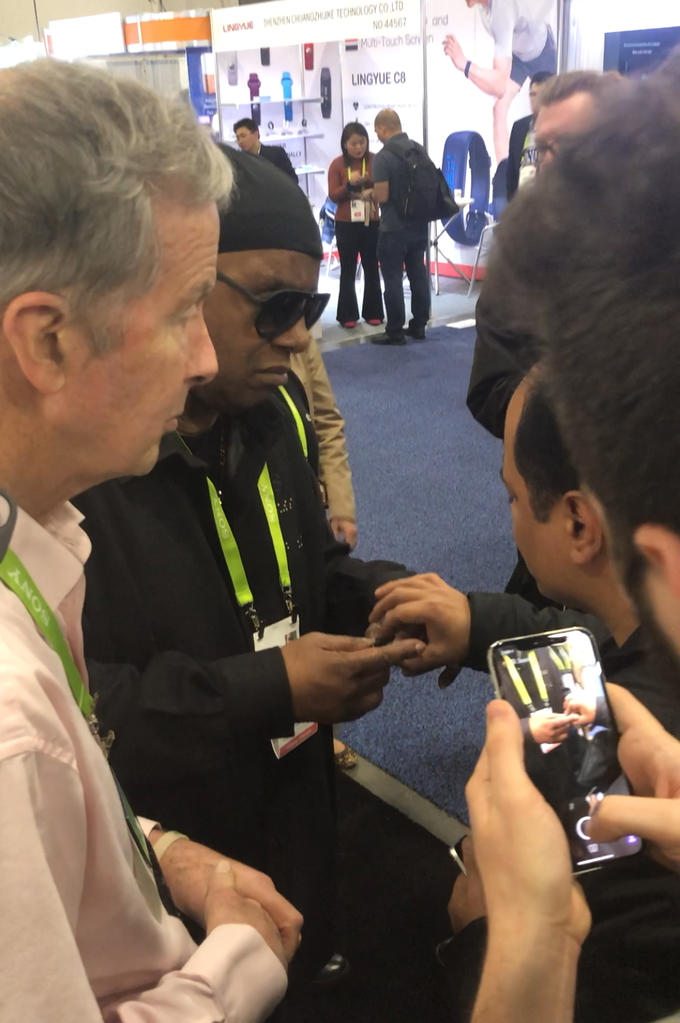 Stevie Wonder checking out Jinni at our CES booth. He was impressed with Jinni, its Alexa features and usability for visually impaired.